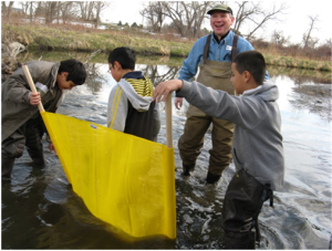 Students in Aurora, CO kick-net for macro-invertebrates. Photo: Earth Force