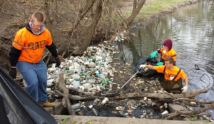 Volunteers clear trash from the river channel. Photo: KSU Pollution Prevention Institute