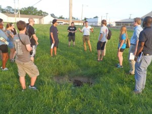 Students consider brownfield sites for re - use as green space and green infrastructure projects. Credit: Clean Air Council
