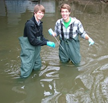 Students conduct water quality monitoring on Plaster Creek
