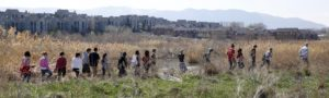 Jordan High School students enter Sandy, Utah, restoration site during CDEA