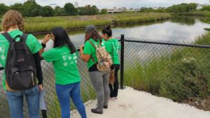 Groundwork Elizabeth Green Team students use a recently installed lookout point to view the Elizabeth River. Photo: Groundwork Elizabeth.